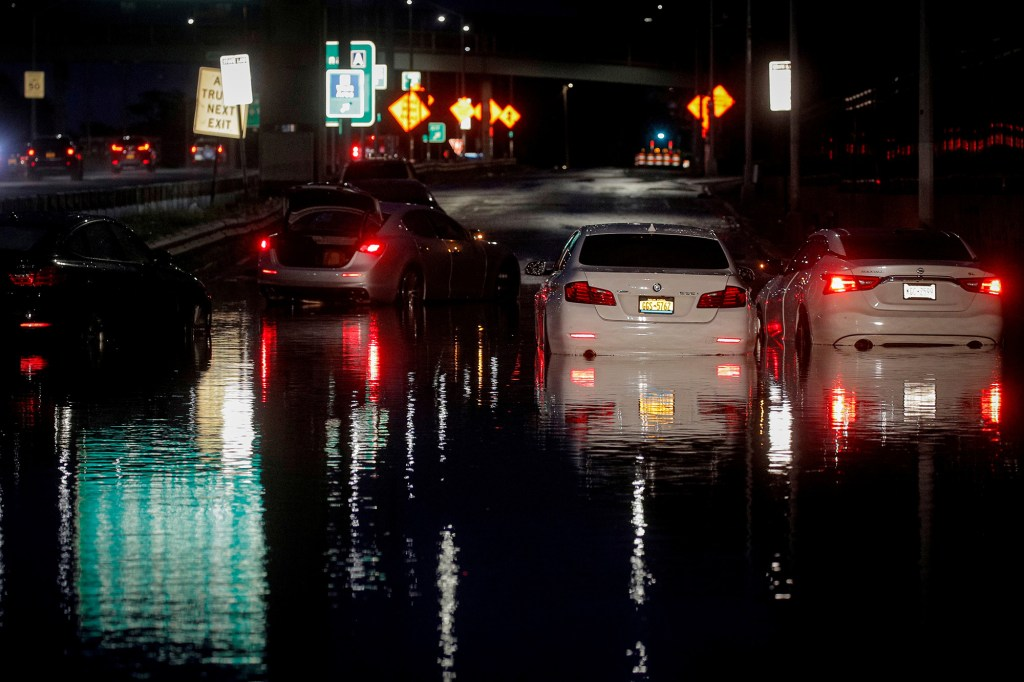 Abandoned cars are left on a flooded highway
