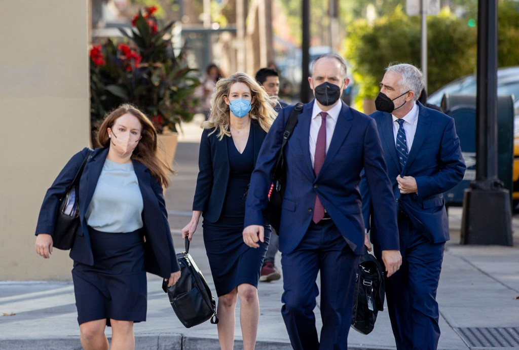 Elizabeth Holmes seen with her lawyers arriving for jury selection.