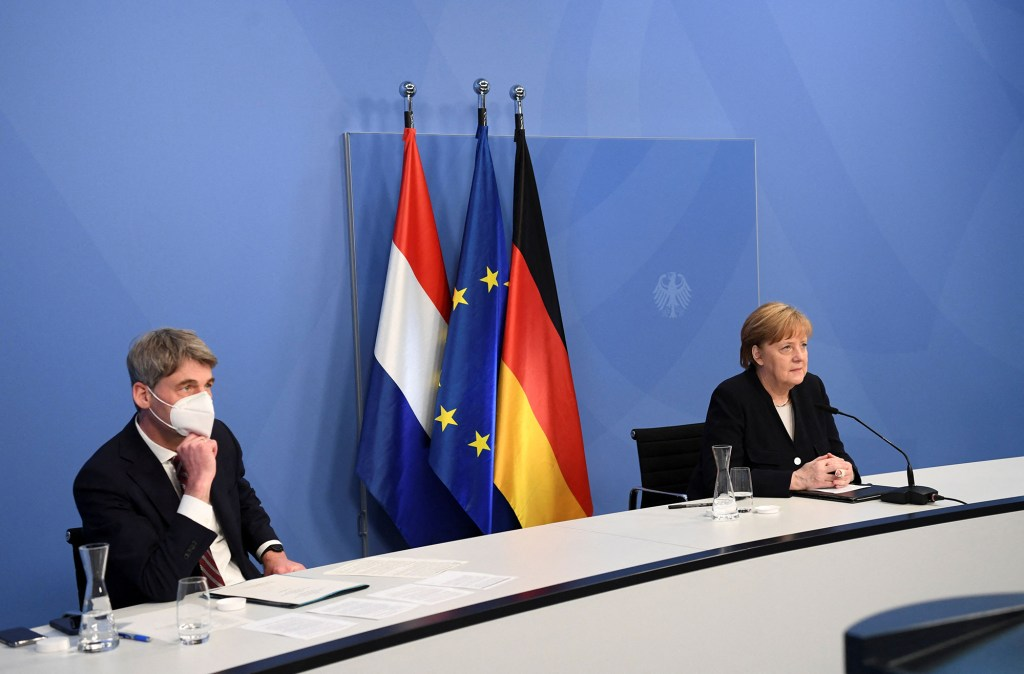 German Chancellor Angela Merkel and foreign policy adviser Jan Hecker.