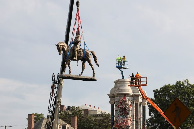Workers dismantle the statue of Confederate General Robert E. Lee in Richmond, Virginia, on September 8, 2021.