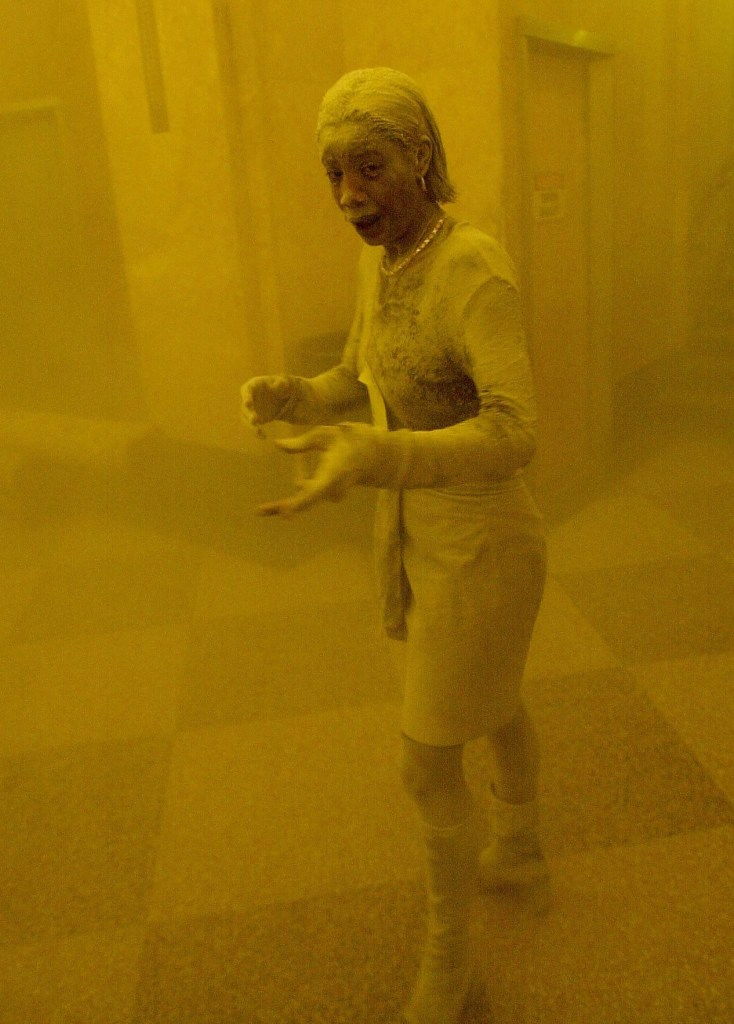 """Marcy Borders fled her World Trade Center office on Sept. 11 -- a cloud of dust chased her on the way out. A photographer that day snapped this image of her, which gave her the """"Dust Lady"""" nickname."""