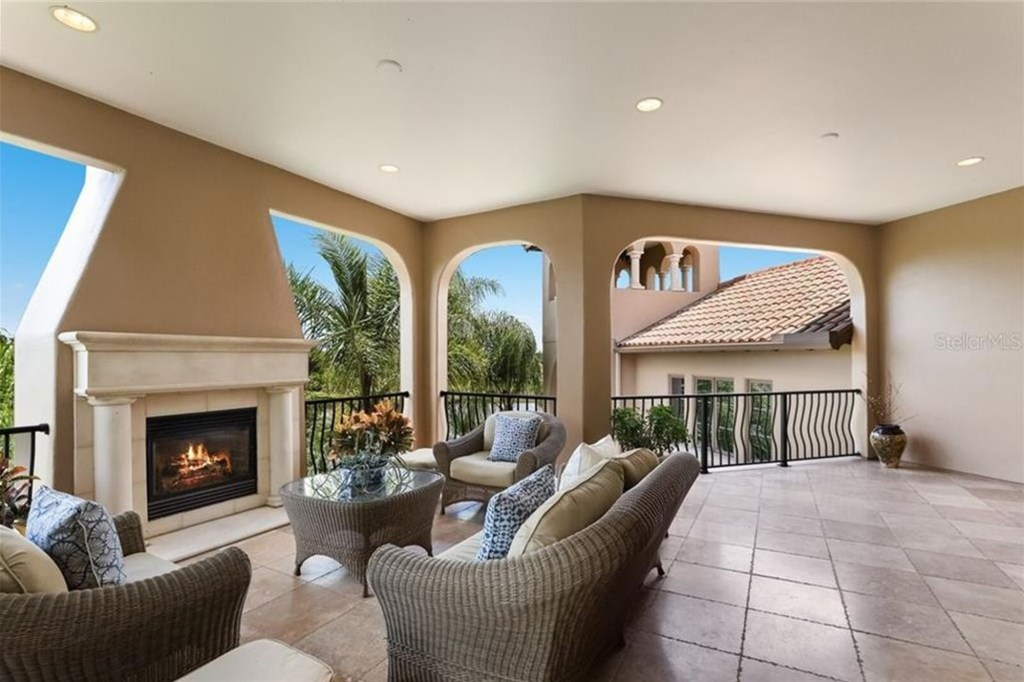 The ensuite terrace with a fireplace.