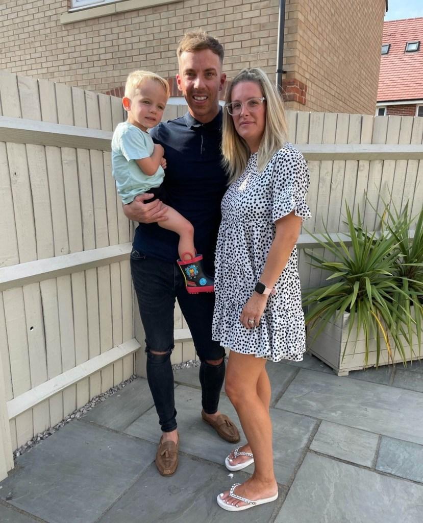 Dan and Kate Harman pose with son Buddy.