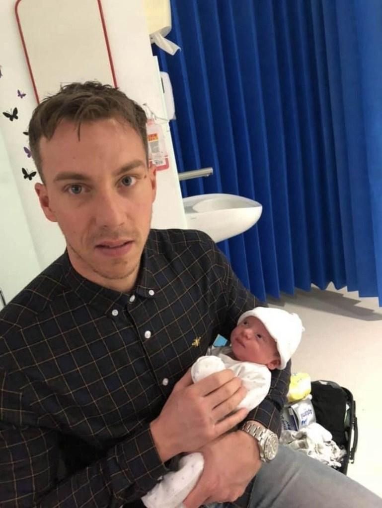 New dad Dan Harman bonds with his newborn son Buddy.