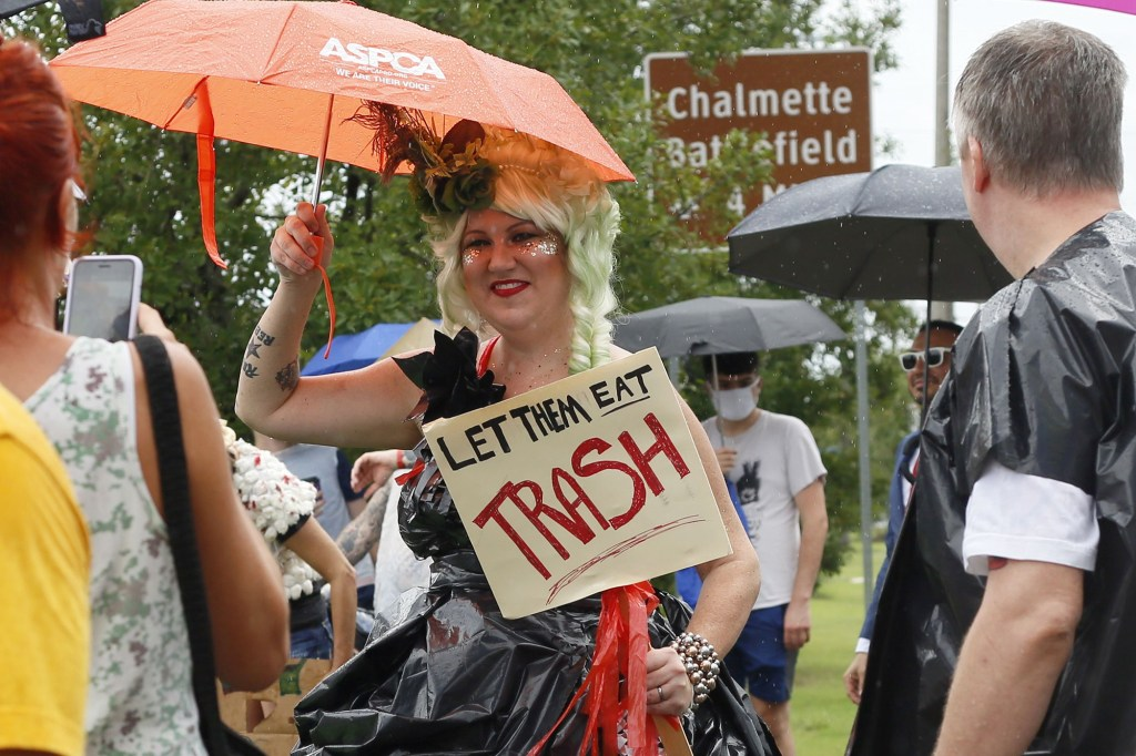 """Roughly 100 people took part in the """"New Orleans Trash Parade"""" on Saturday, marching to City Hall while demanding their rubbish gets removed as soon as possible."""