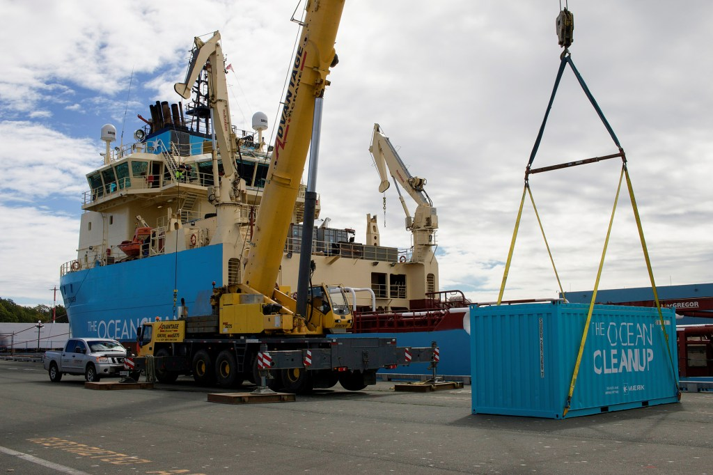 A crane loads an empty container to be filled with plastic garbage collected by the non-profit the Ocean Cleanup during a test run in the North Pacific in Victoria, Canada, September 8, 2021.