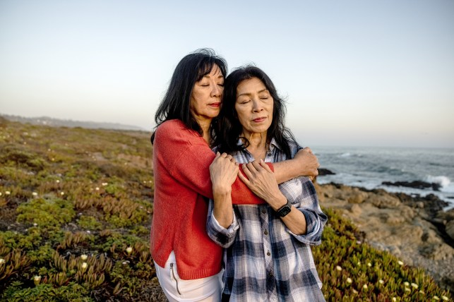 Betty Ong's sisters, Kathy Ong Herrera and Gloria Ong Woo, pose for a photo at the Fisklini Ranch in Cambria, CA.