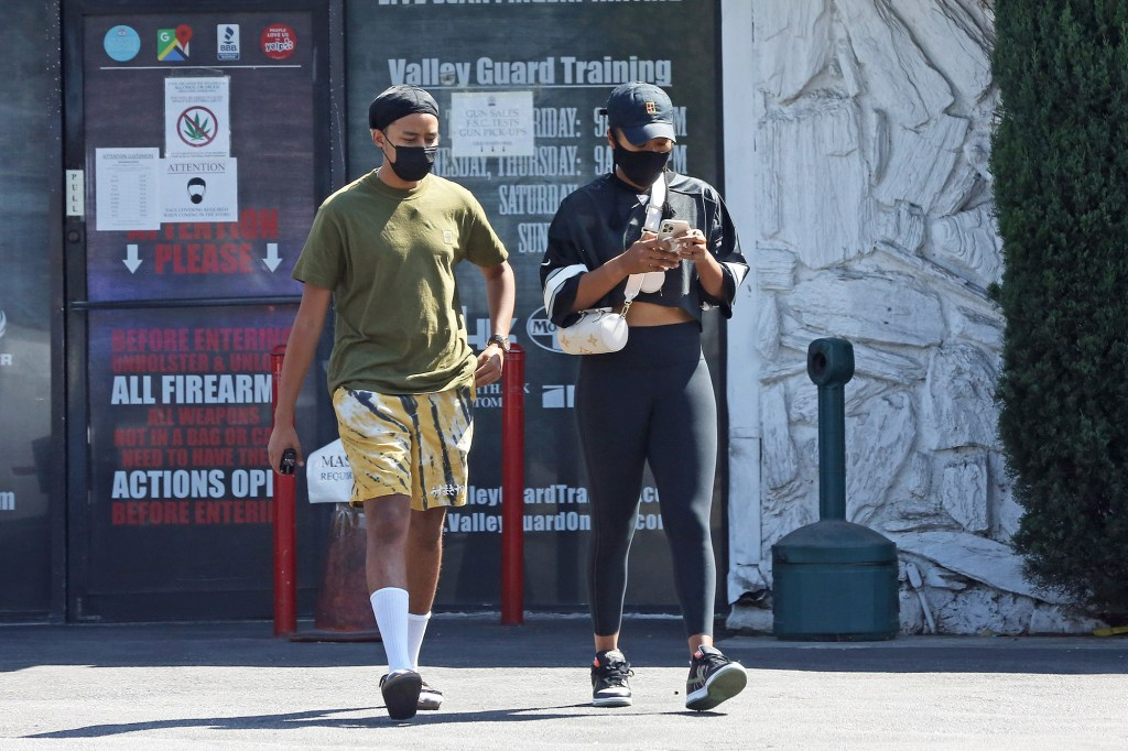 Naomi Osaka and an unidentified companion are seen leaving The Target Range shooting range in Van Nuys.