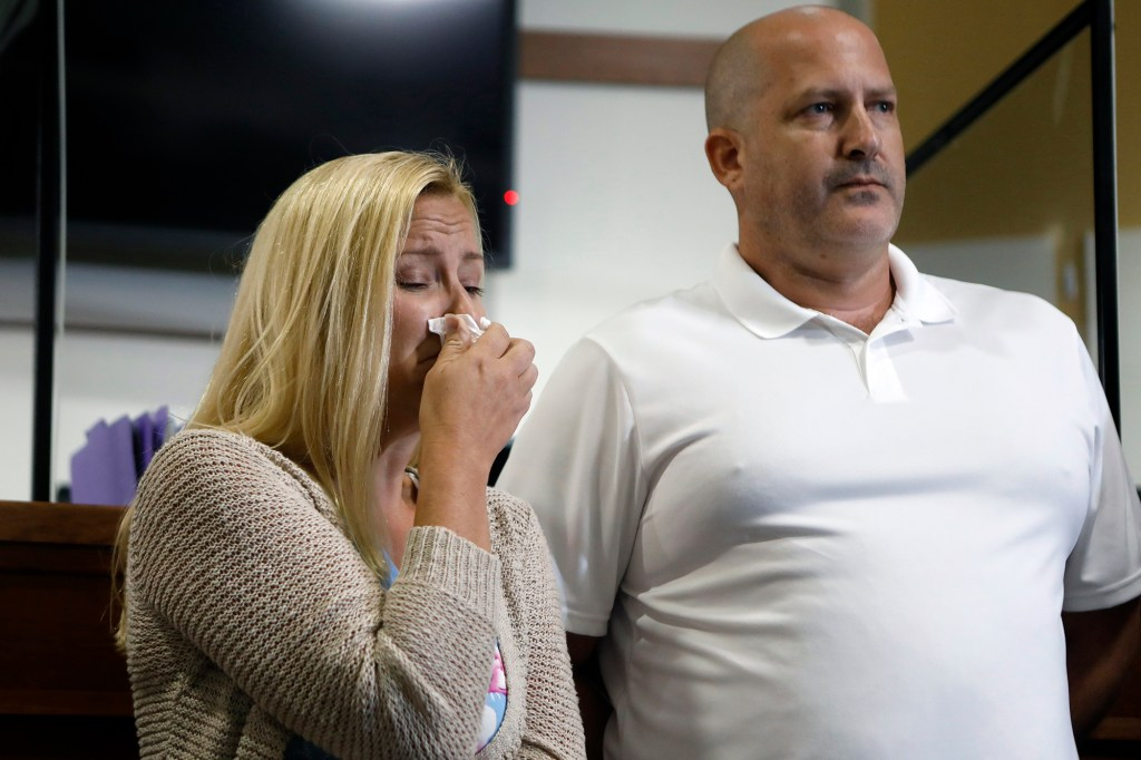 Gabby's stepmother Tara Petito and Joe Petito react while the City of North Port Chief of Police Todd Garrison speaks during a news conference.