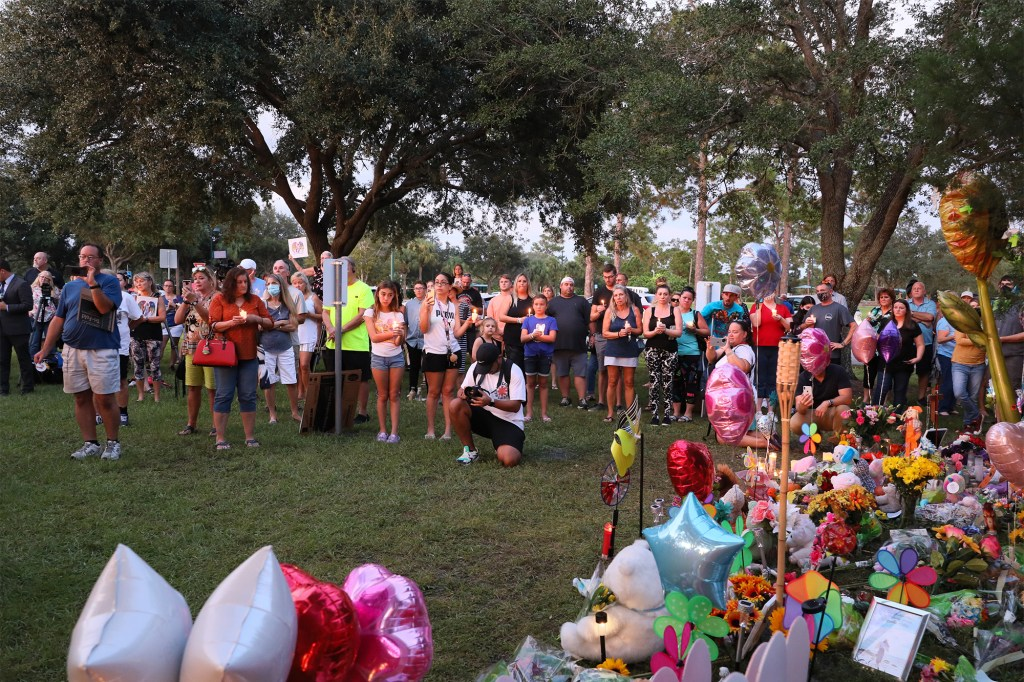 A crowd of people attending a candlelight vigil for Gabby Petito in North Port, Florida on September 25, 2021.