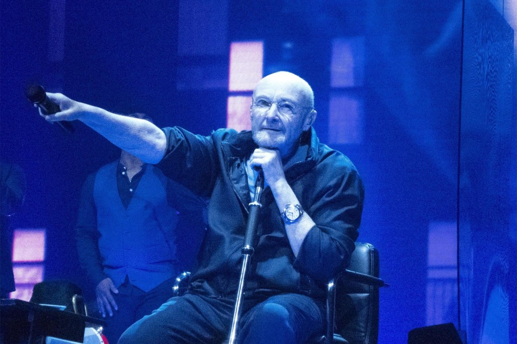 Phil Collins Performing During Genesis Last Domino Reunion Tour on First Night at Utilita Arena Birmingham. This is the bands first live performance in 13 years