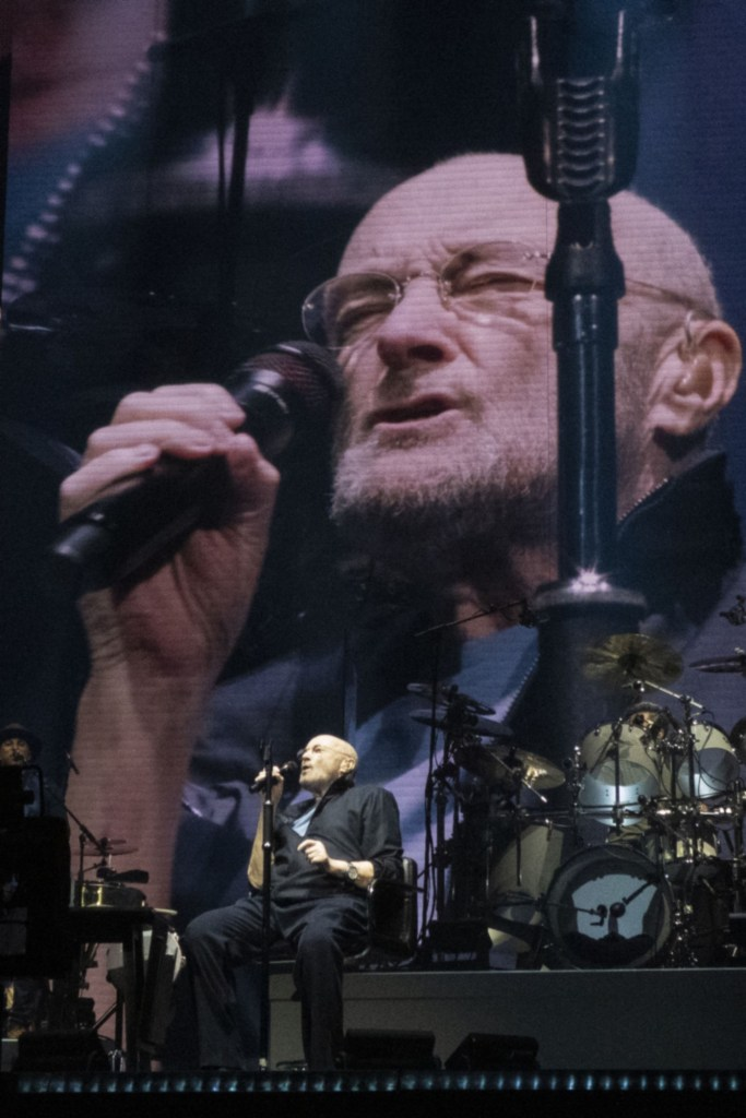 Phil Collins singing with Genesis in the UK.