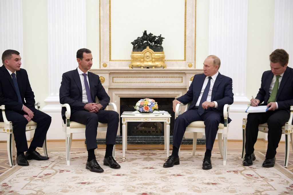 Russian President Vladimir Putin attends a meeting with Syrian President Bashar al-Assad at the Kremlin in Moscow, Russia.