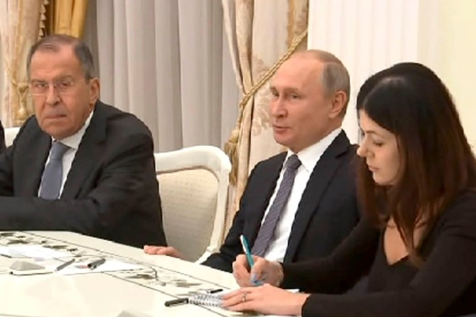 President Vladimir Putin (center) and Daria Boyarskaya (right) at a meeting with Foreign Minister Sergei Lavrov (left) and US National Security Assistant John Bolton.