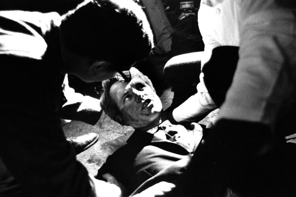 Presidential candidate Robert F. Kennedy lies on the floor at the Ambassador Hotel in Los Angeles moments after he was fatally shot in the head by Sirhan Sirhan.
