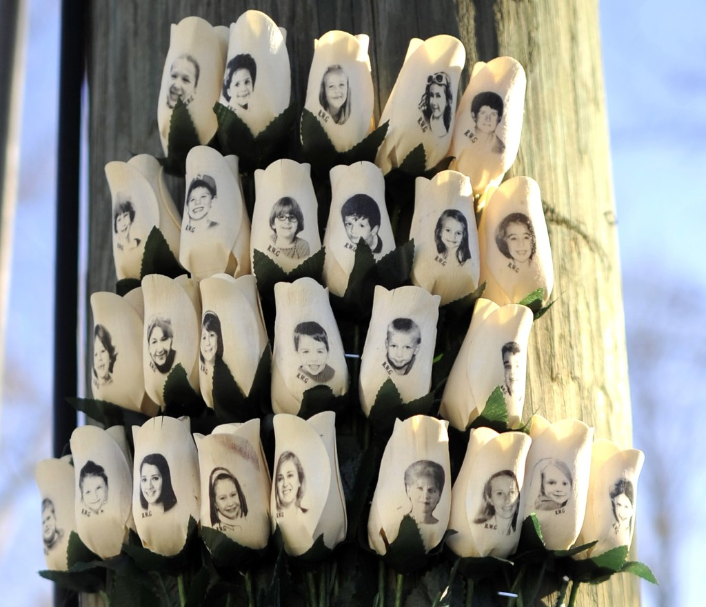 Roses with the faces of the Sandy Hook Elementry students and adults who died in the massacre were placed on a pole in Newtown, Connecticut.