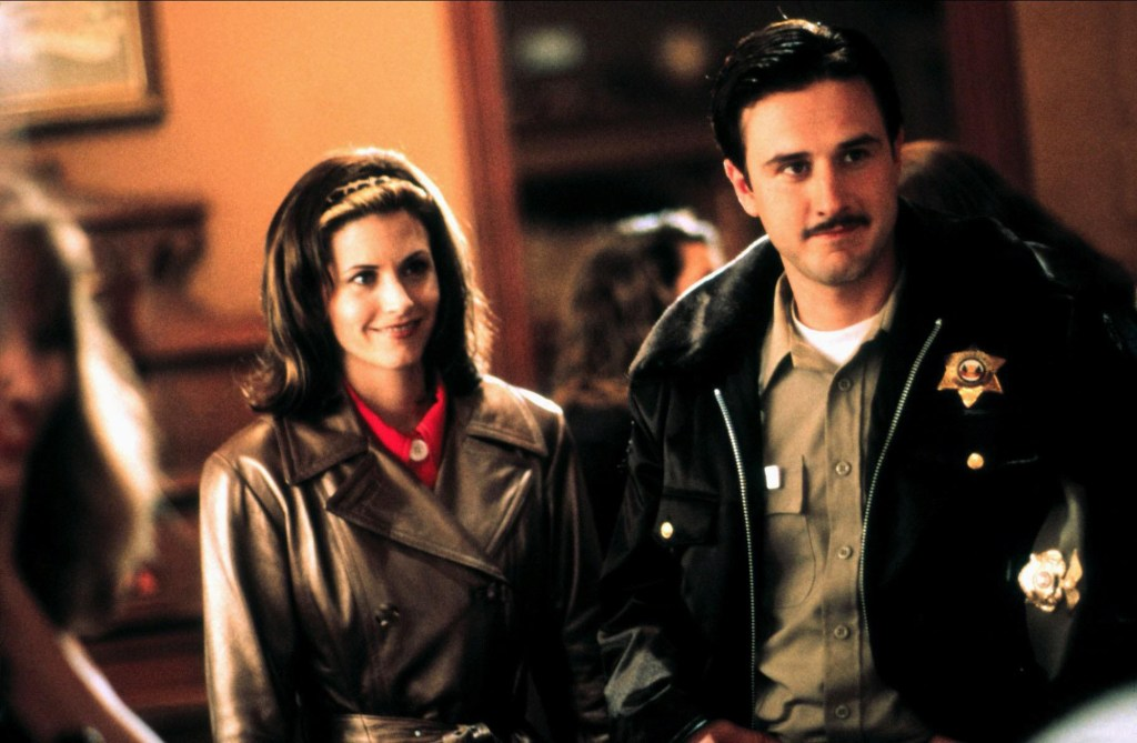"""Courteney Cox and David Arquette play Gale Weathers and Dewey Riley in the original """"Scream"""" movie."""
