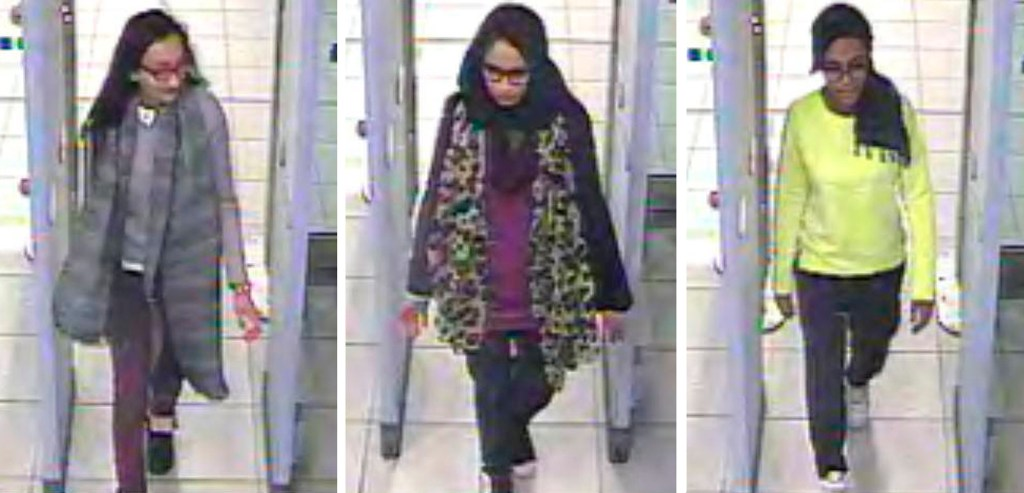 Shamima Begum (center) walks through security at Gatwick airport, before they catching a flight to Turkey in 2015.