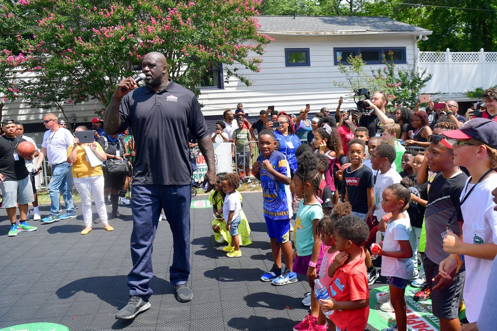 Shaquille O'Neal attends Shaq's Papa John's Pizza Grand Opening