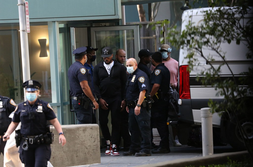 Police and others gather outside of Michael K. Williams' apartment building at 440 Kent Ave.