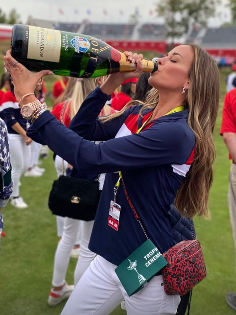 Jena Sims chugs a bottle of champagne after the US won the Ryder Cup.