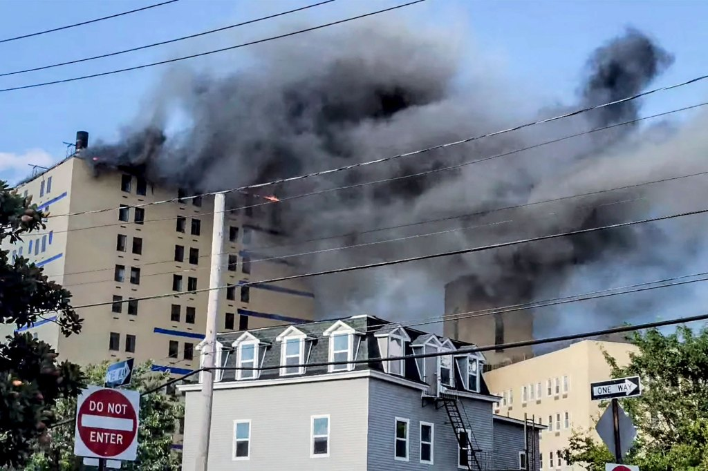 """Hospital employees evacuated patients from the burning hospital in an """"all-hands-on-deck effort."""""""