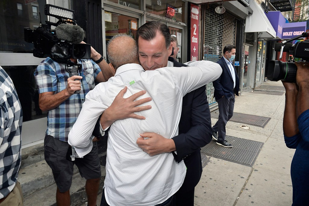 Wali embracing Suozzi after the congressman helped his wife and children escape Afghanistan.