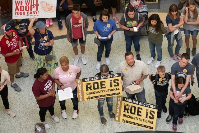 anti-abortion rights demonstrators gather in the rotunda at the Capitol while the Senate debated anti-abortion bills in Austin, Texas.