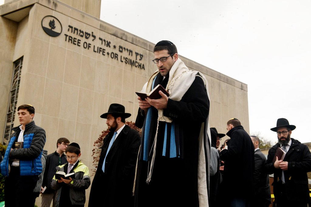 Members of the Jewish faith gather in front of the Tree of Life Synagogue for the Shabbat on Friday, Nov. 2, 2018.