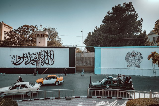 The Taliban's white and black banner, which features an Islamic statement of faith, was painted along a roadway and in front of a security watchtower.