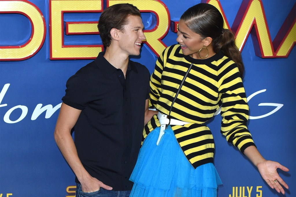 """Tom Holland and Zendaya get close at the London premiere for the 2017 movie """"Spider-Man: Homecoming."""""""