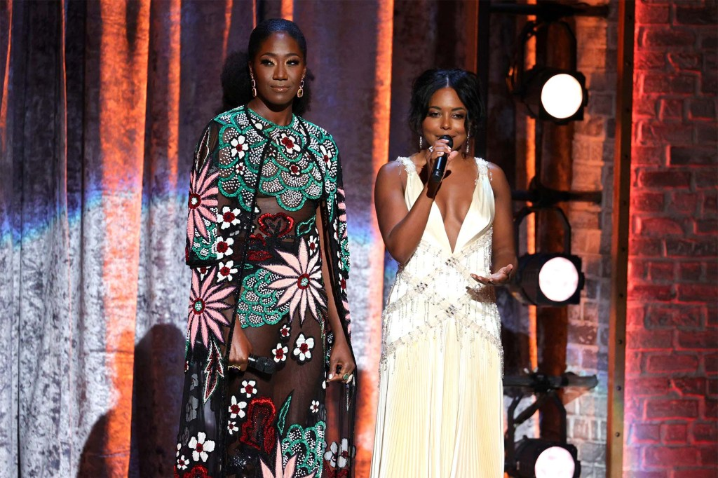 Amber Iman and Adrienne Warren speak onstage during the 74th Annual Tony Awards.