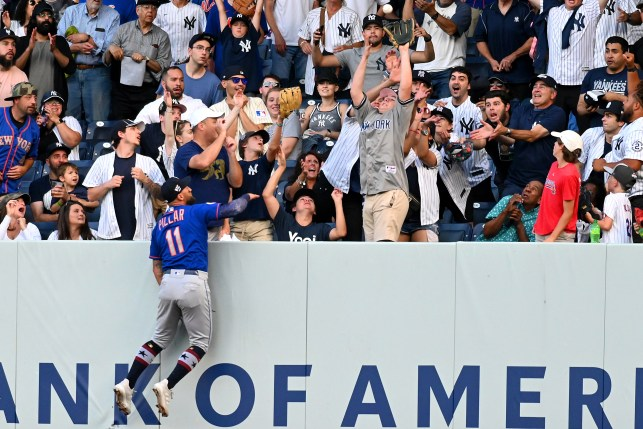 Kevin Piller jumps on the wall of Yankee Stadium on July 4, 2021, at the home run of Geo Archila.