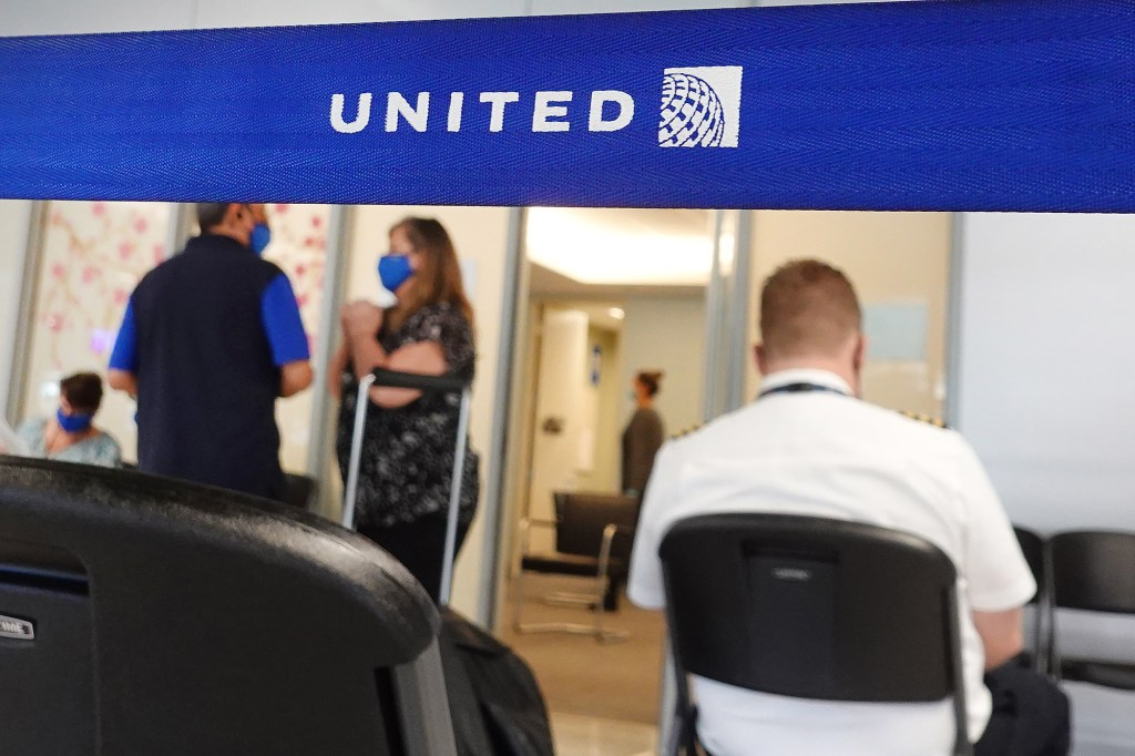 The airline staff who sought exemptions would be placed on temporary unpaid leave starting next month.