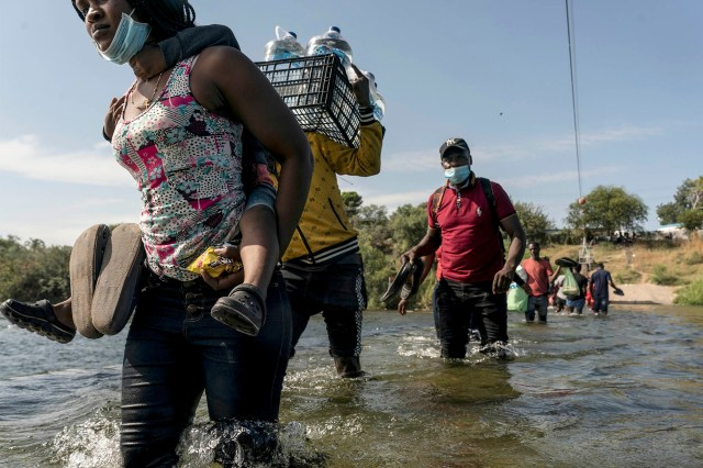 Hundreds of people have been reportedly traveling across the Rio Grande to Mexico to gather supplies as they wait to be processed.