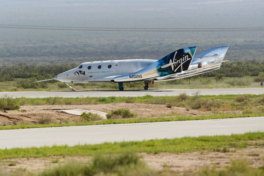 The Virgin Galactic SpaceShipTwo space plane Unity returns to earth after the mothership separated at Spaceport America, near Truth and Consequences, New Mexico