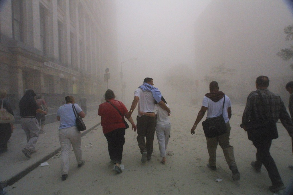 People seen fleeing the area near the World Trade Center after a tower collapsed.