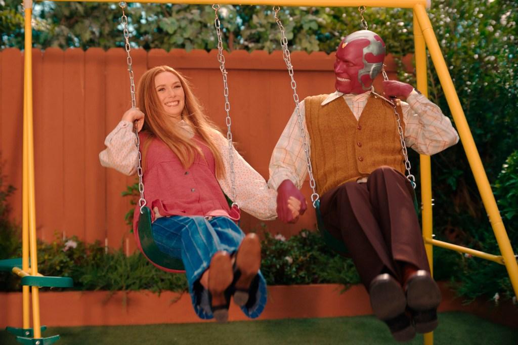 "Elizabeth Olsen, left and Paul Bettany in a scene from ""WandaVision."""