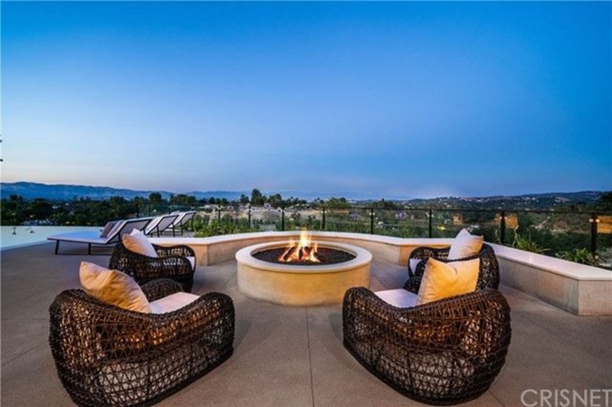 Outdoor seating with a fireplace.