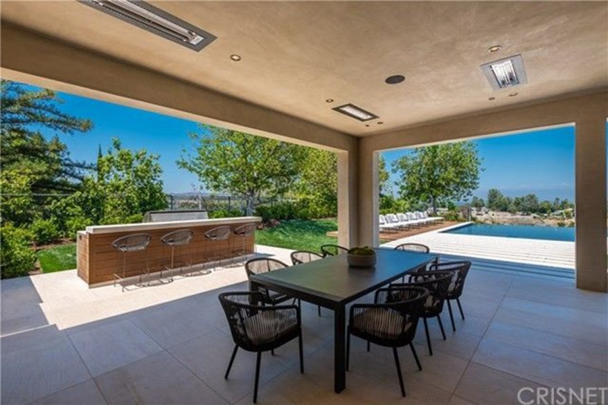 The outdoor loggia for al fresco dining and a BBQ area.