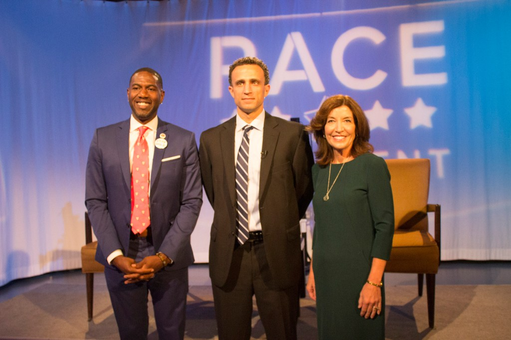 Jumaane Williams (left) during the Lt. Governor debate to which he lost to Kathy Hochul (right).