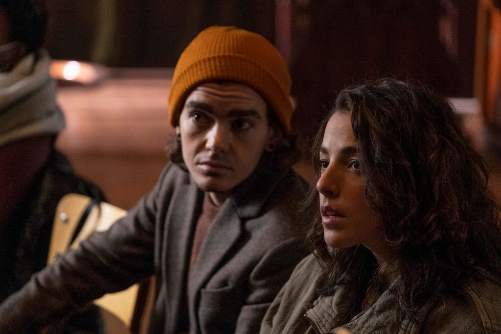 """Photo showing Elliot Flechter, wearing an orange wool cap, and Olivia Thirlby in a scene from """"Y: The Last Man."""""""