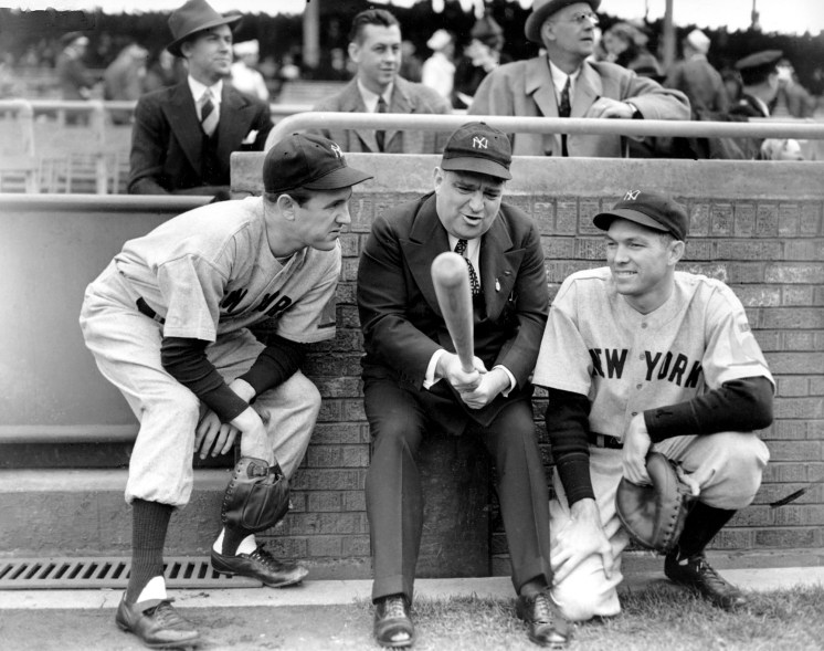 """New York Yankees pitcher Vernon """"Lefty"""" Gomez, left, and catcher Bill Dickey huddle with New York City Mayor Fiorello H. La Guardia after winning the World Series game opener against the Chicago Cubs, 3 to 1, in Chicago, Ill., Oct. 5, 1938."""