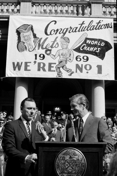 Gil Hodges, left, and New York Mayor John Lindsay are pictured during the awarding of medals to the New York Mets on Mets Day, Oct. 20, 1969.