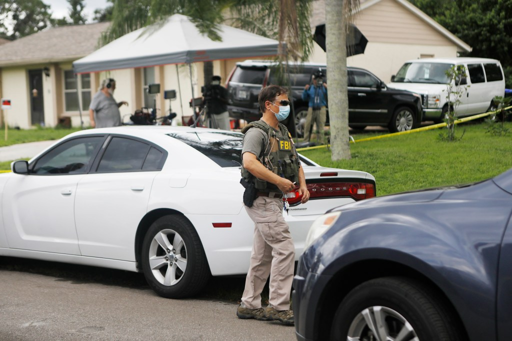 FBI agents take away evidence from the home of Brian Laundrie to use in the manhunt.