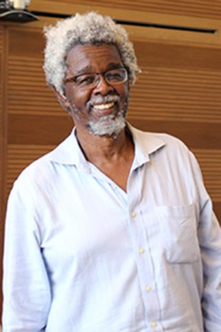 Associate Professor Carlton Jama Adams has been accused of saying xenophobic, sexist and vulgar remarks about Judith Sandrine Dikambi's African heritage.