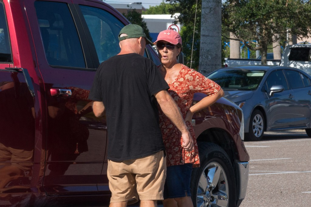 Christopher and Roberta Laundrie seen outside their home in Florida.