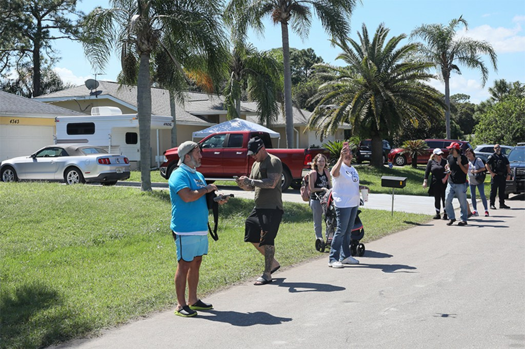 Protesters gather outside the home of Brian Laundrie in North Port, Florida on October 2, 2021.