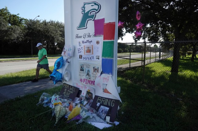 Flowers adorned a memorial for slain college student Mia Marcano at Flagan High School in Pembroke Pines.