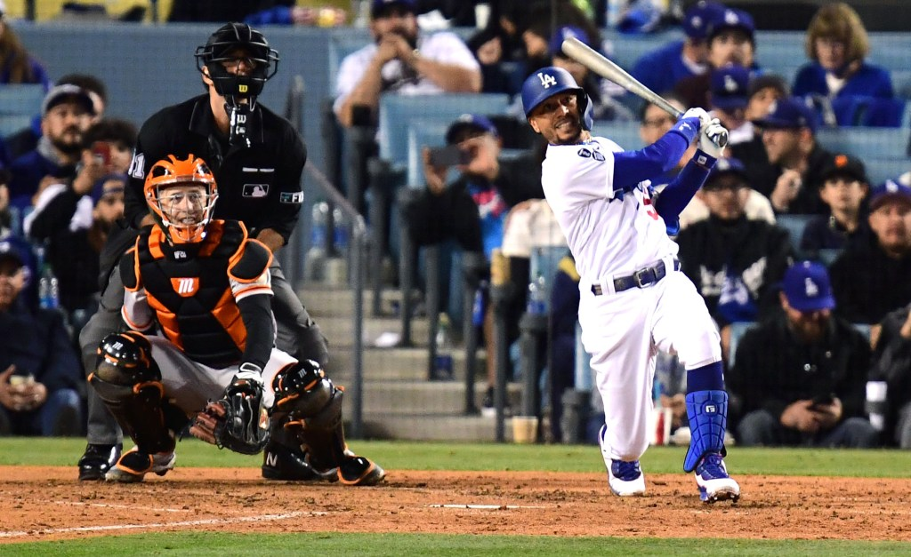Mookie Betts belts a two-run homer in the fourth inning of the Dodgers' 7-2 win over the Dodgers in Game 4 of the NLDS.
